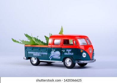 Kiev Ukraine - May 29, 2019. Toy model of Volkswagen Type 2, T1, Pickup 2 with cannabis leaves on the board