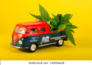 Kiev Ukraine - May 29, 2019. Toy model of Volkswagen Type 2, T1, Pickup with cannabis leaves on the board