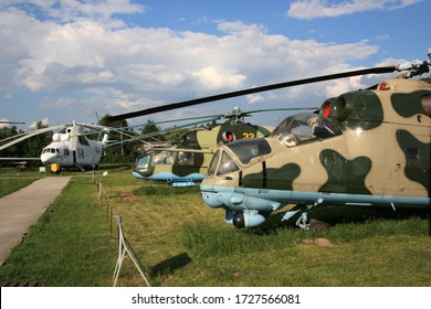 "Kiev, Ukraine - May 29th 2013: Soviet aviation legends next to each other, a Mi-24A ""Stakan"", Mi-24D ""Hind"" and a Mi-26 ""Halo"" at the Zhulyany State Aviation Museum of Ukraine"