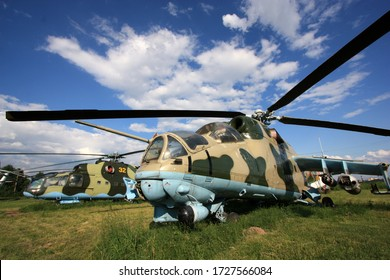 "Kiev, Ukraine - May 29th 2013: Exterior view of a Mil Mi-24A ""Stakan"" and it's successor, the Mi-24D ""Hind"", on display side-by-side at the Zhulyany State Aviation Museum of Ukraine"