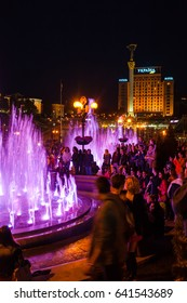 KIEV, UKRAINE - MAY 4, 2017: tourists at the opening of the singing fountains on Maidan Nezalezhnosti (Independence square) of Khreshchatyk street in Kiev city in night.