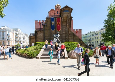KIEV, UKRAINE - MAY 5, 2017: tourists near Golden Gate Monument (Golden Gates of Kiev) in Kyiv city. The Golden Gates were built in 1017-1024, the modern gates was completely rebuilt by in 1982