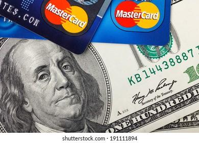 KIEV, UKRAINE - May 5: MasterCard credit cards with US dollar bills, in Kiev, Ukraine, on May 5, 2014.