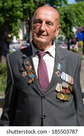 KIEV, UKRAINE - MAY 9, 2013: Ceremonial parade at Kiev main street Khreschatyk dedicated to the 68th anniversary of victory in Great Patriotic War ( World War II ). Unidentified participant