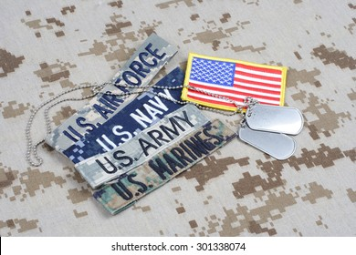 KIEV, UKRAINE - May 9, 2015. US MILITARY concept with branch tapes and dog tags on camouflage uniform background