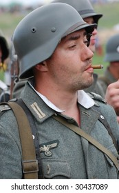 KIEV, UKRAINE - MAY 9: A member of a military history club Red Star wears a historical German uniform as he participates in a WWII reenactment May 9, 2009 in Kiev, Ukraine.