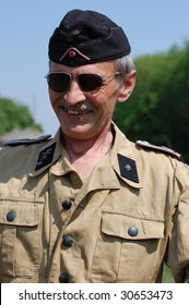 KIEV, UKRAINE - MAY 9: Member of a military history club wear historical German uniform as he participates in a WWII reenactment May 9, 2009 in Kiev, Ukraine.
