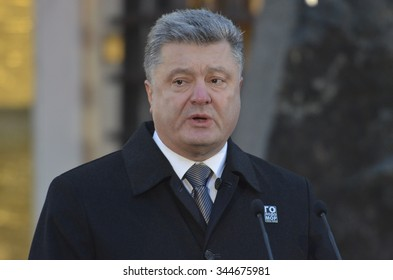 KIEV, UKRAINE - Nov 28, 2015: President of Ukraine Petro Poroshenko and his wife commemorated the victims of the famine-genocide of 1932-1933 in Ukraine
