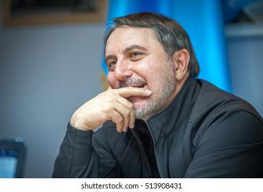 KIEV, UKRAINE - NOV 3, 2016: Lenur Islyamov leader of the Crimean Tatar national movement in Ukraine and worldwide. Flag of Mejlis of the Crimean Tatar People and Ukraine flag. protest movement