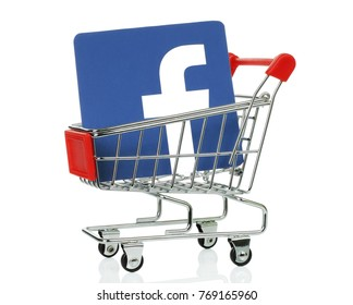 Kiev, Ukraine - November 01, 2017: Facebook icon printed on paper and placed into shopping cart. Facebook is a well-known social networking service