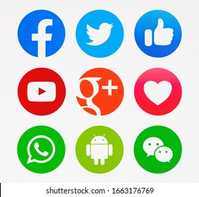 Kiev, Ukraine - November 04, 2019 : New Facebook, Twitter, YouTube, Google Plus, like button and love, WhatsApp, Android, WeChat printed on paper.