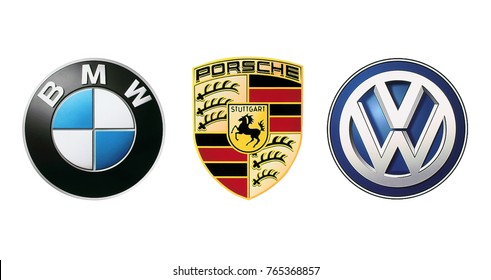 Kiev, Ukraine - November 09, 2017: Collection of popular car logos printed on white paper: Volkswagen, BMW and Porsche