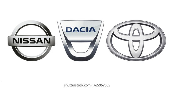 Kiev, Ukraine - November 09, 2017: Collection of popular car logos printed on white paper: Nissan, Dacia and Toyota