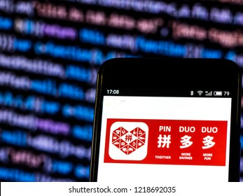 KIEV, UKRAINE - November 1, 2018: Pinduoduo  logo seen displayed on smart phone. Pinduoduo is an e-commerce platform allowing users to participate in group buying deals.