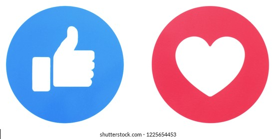 Kiev, Ukraine - November 2,  2018: Facebook like and love icons of Empathetic Emoji Reactions, printed on paper. Facebook is a well-known social networking service.