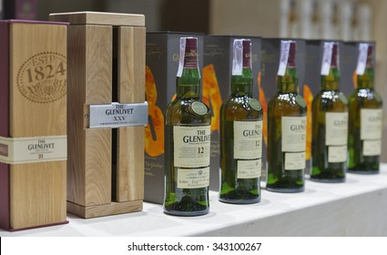 KIEV, UKRAINE - NOVEMBER 21, 2015: The Glenlivet 12 years old Single Malt Scotch Whisky bottles closeup in a row for tasting on booth at 1st Ukrainian Whisky Dram Festival in Parkovy Exhibition Center