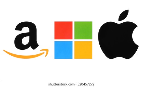 Kiev, Ukraine - November 21, 2016: Collection of popular internet companies logos printed on white paper: Amazon, Microsoft and Apple