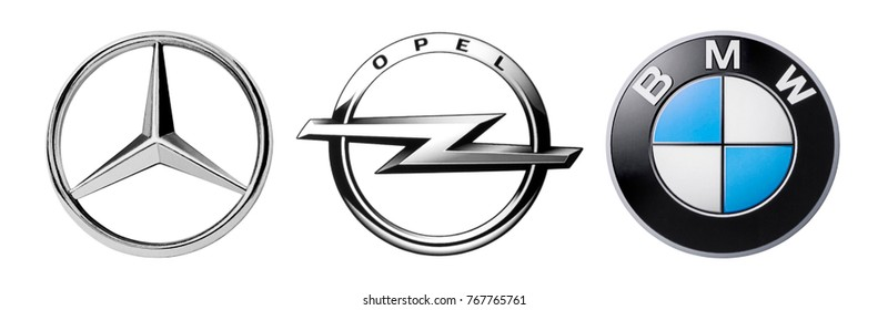 Kiev, Ukraine - November 22, 2017: Set of logos popular German brands of cars: Mercedes, BMW and Opel, printed on paper and placed on white background.