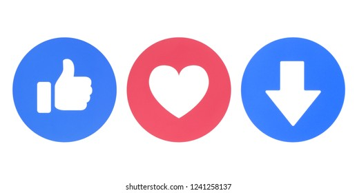 Kiev, Ukraine - November 22, 2018: Facebook Like, Love and new Downvote icons of Empathetic Emoji Reactions printed on paper. Facebook confirms test of a downvote button for flagging comments.