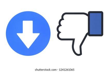 Kiev, Ukraine - November 22, 2018: Facebook dislike and new downvote button of Empathetic Emoji Reactions printed on paper. Dislike thumb illustrates the function of new downvote button.