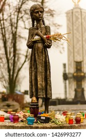 Kiev, Ukraine - November 25, 2017: Bronze statue of hungry girl. Monument to Victims of Famine in 1932 - 1933