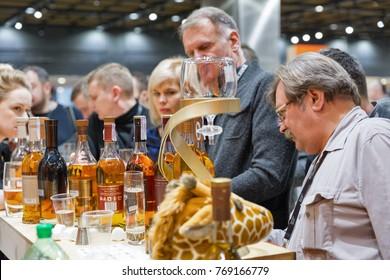 KIEV, UKRAINE - NOVEMBER 25, 2017: Unrecognized people visit Glenmorangie Single Malt Scotch Whisky Highland distillery booth at 3rd Ukrainian Whisky Dram Festival in Parkovy Exhibition Center.