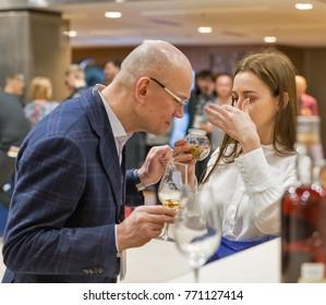KIEV, UKRAINE - NOVEMBER 25, 2017: Unrecognized people tasting Single Malt Scotch Whisky at 3rd Ukrainian Whisky Dram Festival in Parkovy Exhibition Center.