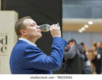 KIEV, UKRAINE - NOVEMBER 25, 2017: Unrecognized man tasting Single Malt Scotch Whisky at 3rd Ukrainian Whisky Dram Festival in Parkovy Exhibition Center.