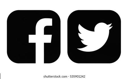 Kiev, Ukraine - November 26, 2016: Facebook and Twitter black icons printed on white paper