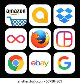 Kiev, Ukraine - November 26, 2016: Collection of popular social media icons printed on black paper: Amazon, Google Allo, Dropbox, Instagram Boomerang, Firefox, Instagram Layout, Chrome, Ebay, Google.