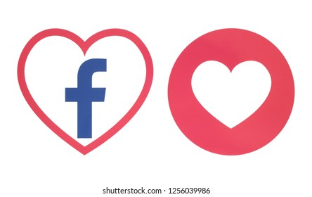 Kiev, Ukraine - November 28, 2018: Facebook heart icon with Love Empathetic Emoji Reaction printed on paper. Illustration of new Facebook feature within Facebook's main app - Facebook Dating.