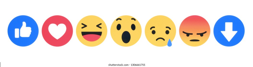 Kiev, Ukraine - November 28, 2018: New Facebook like button 7 Empathetic Emoji Reactions printed on white paper. Facebook tests new Downvote button