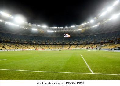 KIEV, UKRAINE - November 29, 2018: Night football stadium close up during the UEFA Europa League match between Vorskla Poltava vs FC Arsenal (England), Ukraine