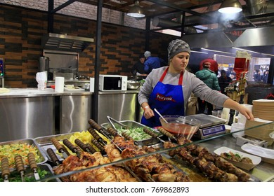 KIEV, UKRAINE - NOVEMBER 4, 2017: Unidentified people cook and trades traditional ukrainian dishes on food stall in Street Food Festival in Kiev, Ukraine. Selective focus
