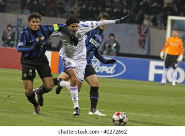 KIEV, UKRAINE - NOVEMBER 4: Javier Zanetti of Inter Milano (L) fights for a ball with Gerson Magrao of Dynamo Kiev (C) during UEFA Champions League Group 6 football match on November 4, 2009 in Kiev
