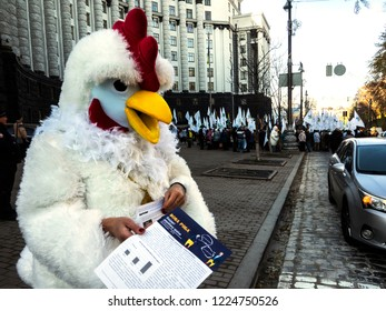KIEV, UKRAINE - November 7, 2018: Dressed in a chicken suit, a woman protests against the allocation of subsidies to chicken producers.