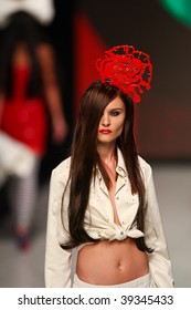 "KIEV, UKRAINE - OCT 15: Model poses at the runway during Fashion Show by ""ZALEVSKIY"" as part of Ukrainian Fashion Week, October 15, 2009 in Kiev, Ukraine."