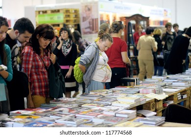 KIEV, UKRAINE - OCT 7: Visitors choose books at the 2-nd International Festival BOOK ARSENAL on October 7, 2012 in Kiev, Ukraine. The guests of the fair were Alessandro Baricco & Josef Winkler