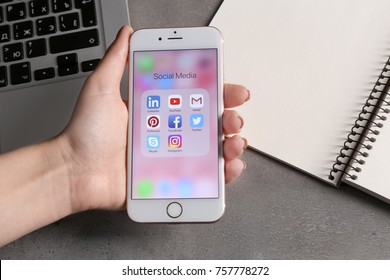 KIEV, UKRAINE - OCTOBER 02, 2017: Woman holding rose gold iPhone 6S with social media icons on screen