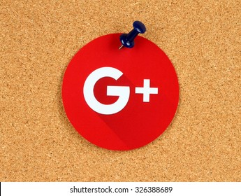 Kiev, Ukraine - October 07, 2015: New Google Plus logo sign printed on paper, cut and pinned on cork bulletin board. Google is USA multinational corporation.
