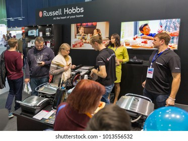 KIEV, UKRAINE - OCTOBER 07, 2017: People visit Russell Hobbs, USA manufacturer home appliances company booth during CEE 2017, largest electronics trade show of Ukraine in ExpoPlaza Exhibition Center.