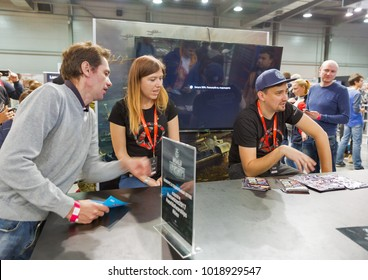 KIEV, UKRAINE - OCTOBER 07, 2017: Unrecognized people visit Wargaming company computer game zone during CEE 2017, the largest consumer electronics trade show of Ukraine in KyivExpoPlaza EC.