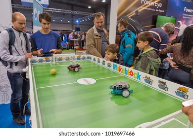 KIEV, UKRAINE - OCTOBER 07, 2017: People visit Makeblock, Chinese brand of robot construction toys at booth during CEE 2017, the largest consumer electronics trade show of Ukraine in KyivExpoPlaza EC.