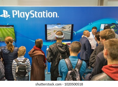 KIEV, UKRAINE - OCTOBER 07, 2017: People visit Sony PlayStation home video game console company booth during CEE 2017, the largest electronics trade show of Ukraine in ExpoPlaza Exhibition Center.