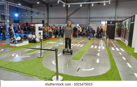 KIEV, UKRAINE - OCTOBER 07, 2017: People testing gyroscooters on Segway electric transport booth at the CEE 2017, the largest exhibition of consumer electronics of Ukraine in KyivExpoPlaza EC.