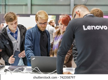 KIEV, UKRAINE - OCTOBER 07, 2017: Unrecognized people visit Lenovo, a Chinese multinational technology company booth during CEE 2017, the largest electronics trade show of Ukraine in KyivExpoPlaza EC.