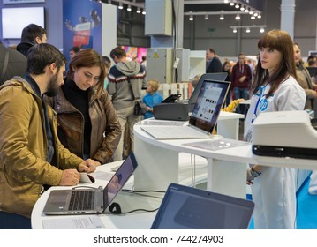 KIEV, UKRAINE - OCTOBER 07, 2017: People visit Hewlett-Packard, American multinational information technology company booth at CEE 2017, largest electronics trade show of Ukraine in KyivExpoPlaza EC.