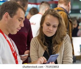 KIEV, UKRAINE - OCTOBER 07, 2017: People visit Huawei, a South Korean multinational corporation booth during CEE 2017, the largest electronics trade show of Ukraine in KyivExpoPlaza EC.