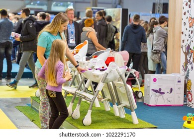 KIEV, UKRAINE - OCTOBER 08, 2017: People visit Oribel, brand created for parenthood products, booth during CEE 2017, the largest consumer electronics trade show of Ukraine in KyivExpoPlaza EC.