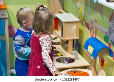 KIEV, UKRAINE - OCTOBER 08, 2017: Kids play at toys booth during CEE 2017, the largest consumer electronics trade show of Ukraine in KyivExpoPlaza Exhibition Center.